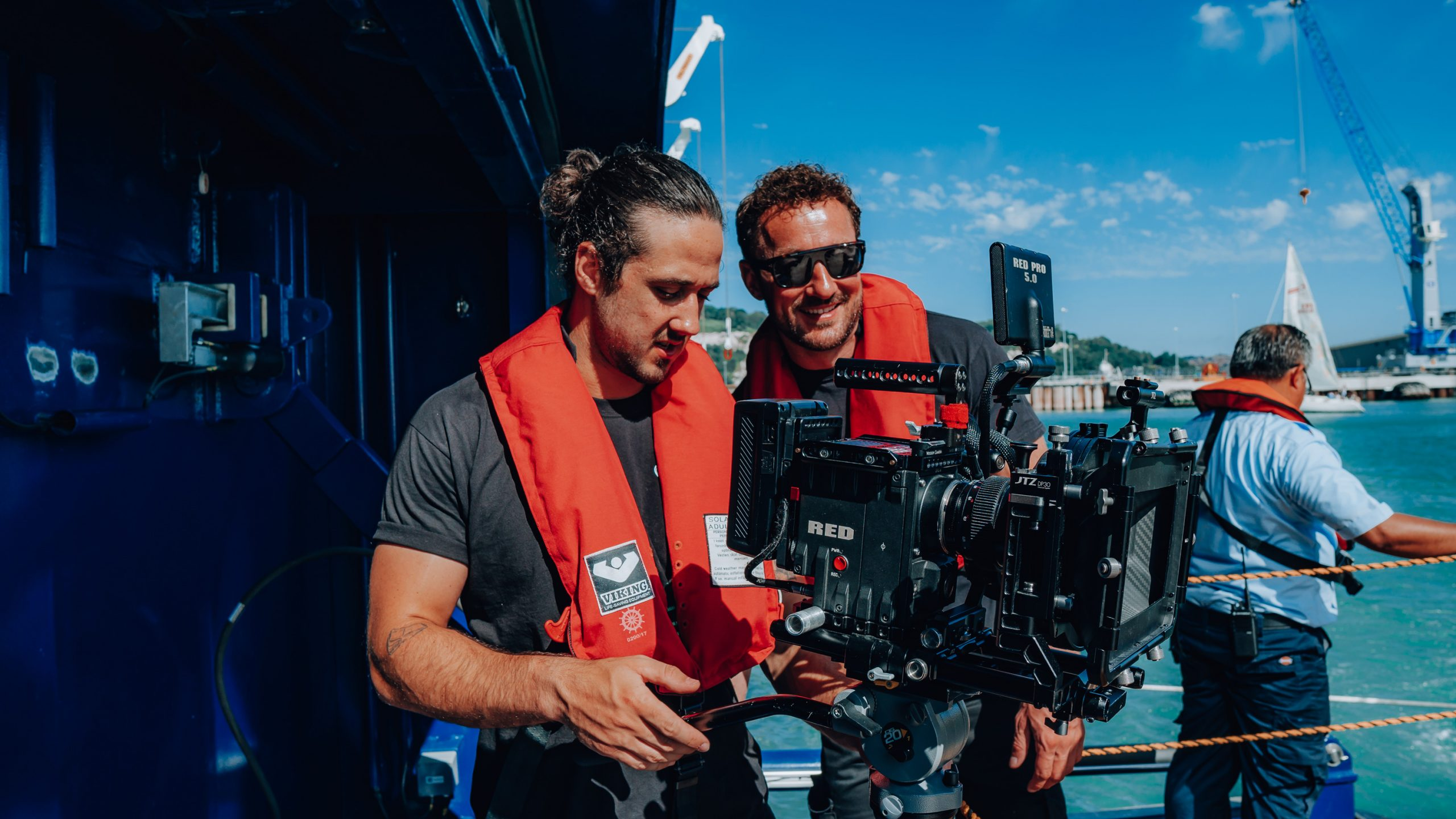 James Rostance directing filming a lifeboat