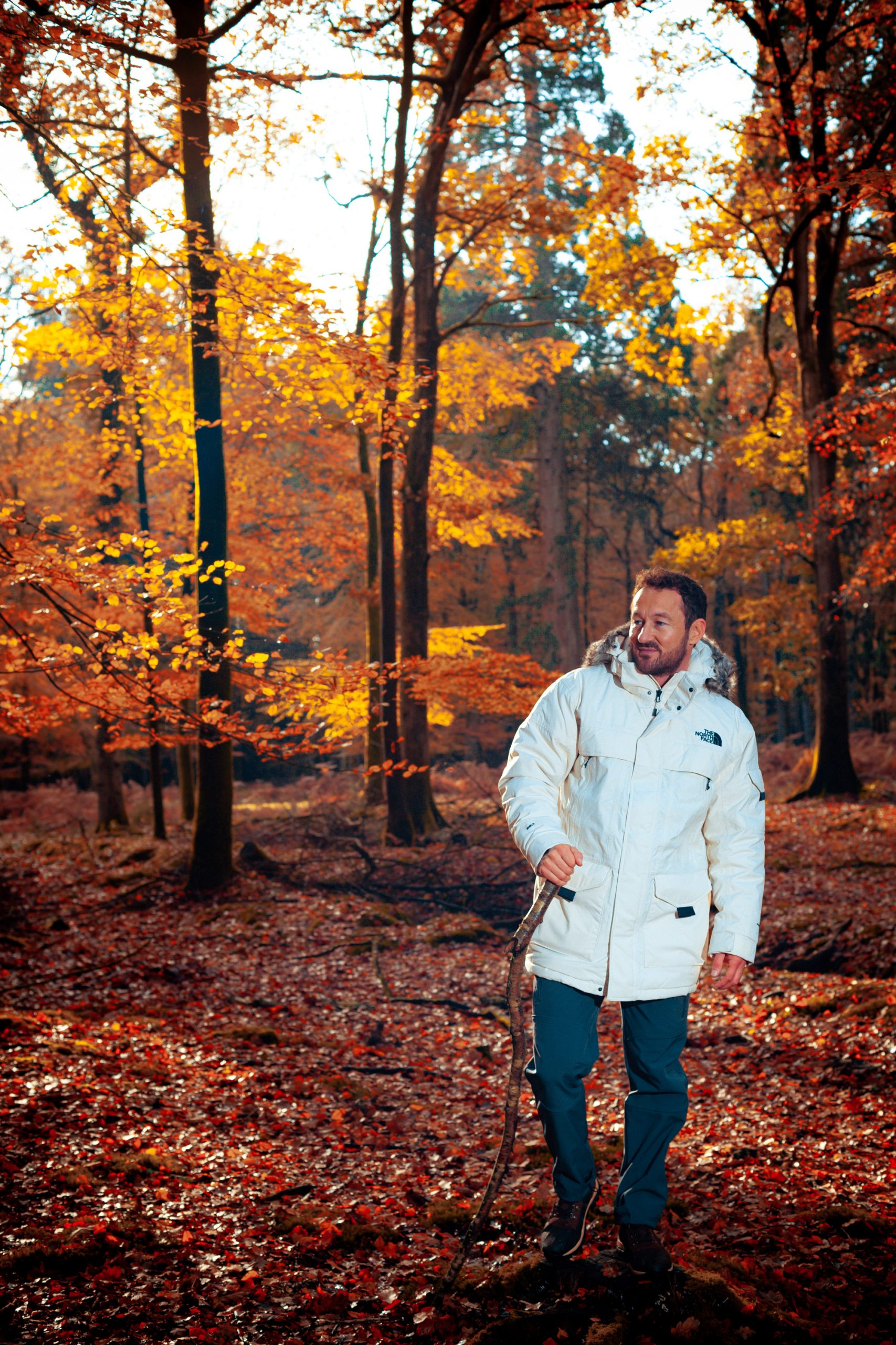 James Rostance walking in the new forest in a white jacket